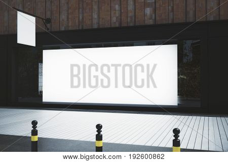 Side view of empty storefront with banner and stopper. Advertisement concept. Mock up 3D Rendering