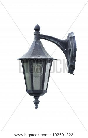 Vintage street lamp with modern bulb inside.