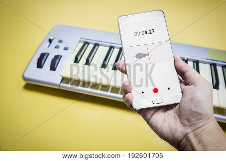 Mobile Phone Is Recording The Sound Of Man Playing Piano