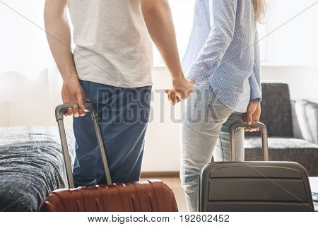 Young man and woman together tourism hotel carry luggage