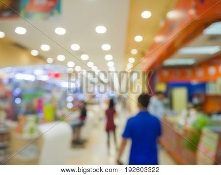 abstract blur in supermarket.Customer shopping at supermarket store with bokeh light.