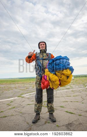 Happy Skydiver Is Standing On The Airfield