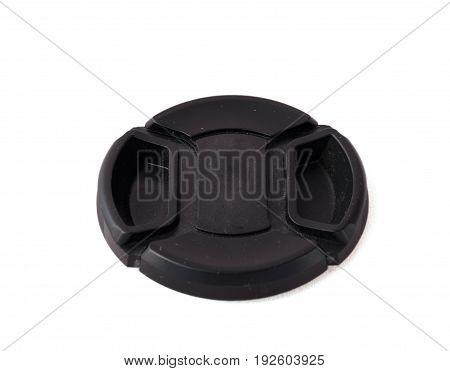 Black camera lens cap isolated over white background