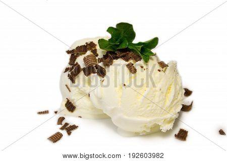 Vanilla ice cream.Two scoops with chocolate.Sweet dessert