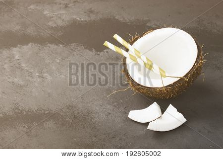 Half Of Ripe Coconut On A Dark Background. Copy Space. Food Background. Toning