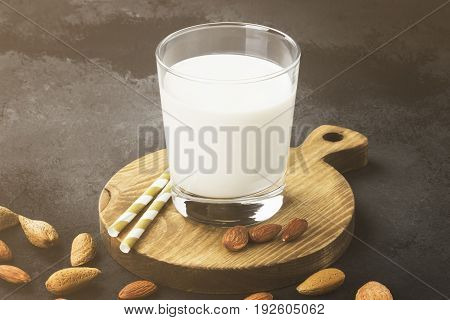 Vegan Almond Milk In Glass On A Dark Background. Non-dairy Milk. Toning