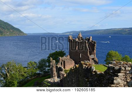 Loch Ness and Urquhart Castle ruins in the Scottish Highlands.