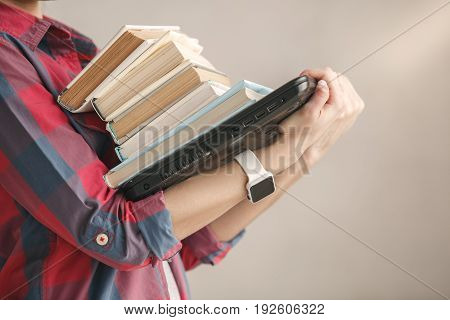 Young female carry books isolated on white