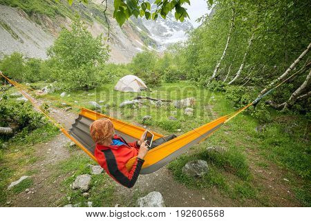 Traveler Relaxing In Hammock, A Camp With Magic View