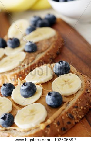 Banana, Blueberries And Peanut Butter On Wholemeal Bagels - Shallow Dof