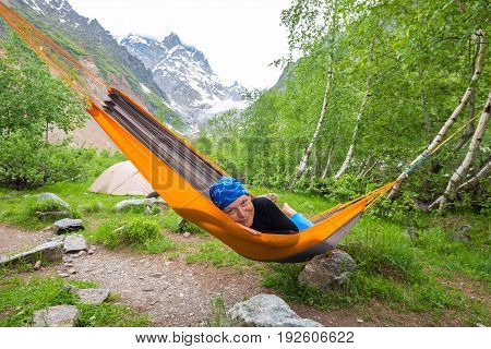 Happy Funny Woman Traveler Relaxing In Hammock In The Mountains