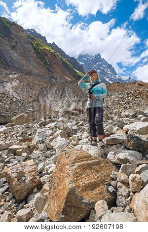 Happy Woman Traveler Stands On A Moraine