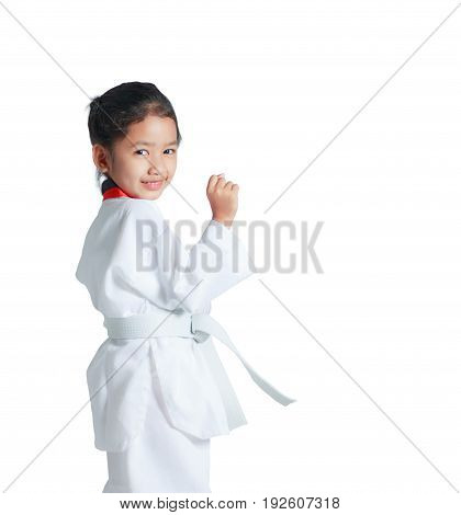Happy Asian little girl is smile and showing fist for guarding in taekwondo uniform isolated on white background with clipping path with copy space