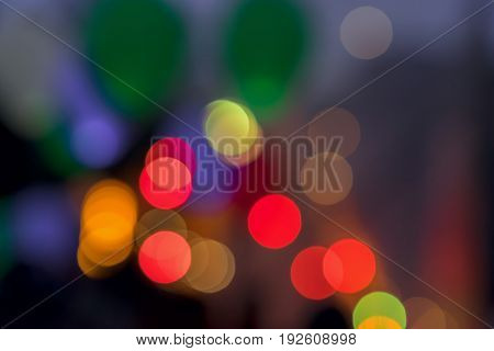 Multicolored glowing Bokeh lights background from LED balloons flying fly away in the sky at night. Abstract background for all occasions, especially festive