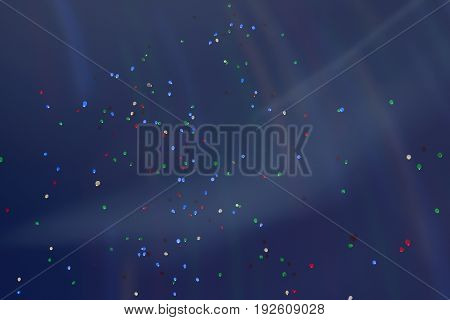 Colorful LED balloons flying fly away in the sky at night with additional iridescent lighting. Many fabulous Balloons glowing in the night sky