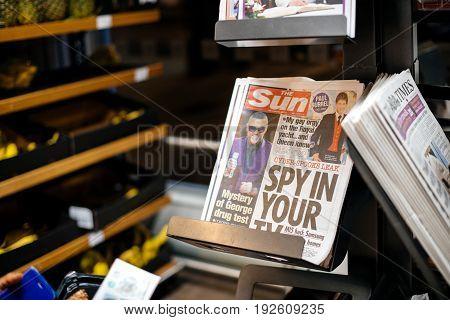 LONDON UNITED KINGDOM - MAR 8 2017: The Sun newspaper featuring headlines of George Michael secret drug test and Paul Burrey gay orgy