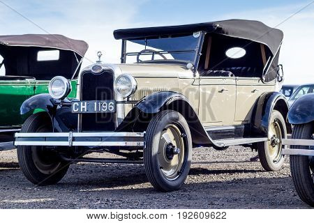 QUEENSTOWN SOUTH AFRICA - 17 June 2017: Vintage brown Chevrolet AB National four door sedan car parked at exhibition