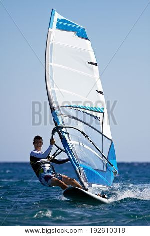 Young Man Surfing The Wind