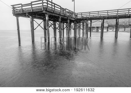 A view from beneath the pier in Redondo Beach Washington. It is raining.