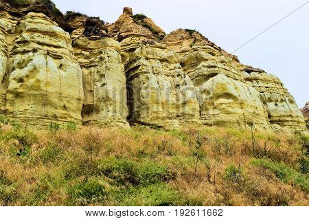 Badlands with sandstone rocks beside coastal shrubs taken in San Clemente CA