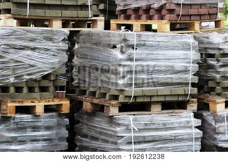 pallets of new concrete blocks grey object