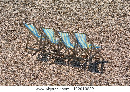 Beach chairs on the pebbles on the Jurassic Coast in Devon