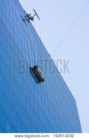 Washing Windows on the outside, industrially, in a high-rise modern building