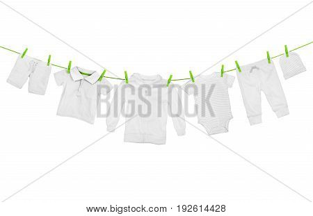 Laundry line with light clothes isolated on white background