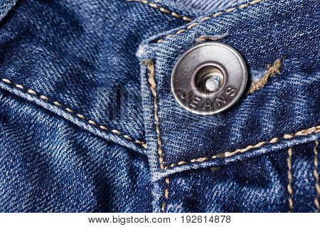 Jeans Close-up. Clasps, Seams, Zippers,  Button. Interlacing The Fabric With A Close-up
