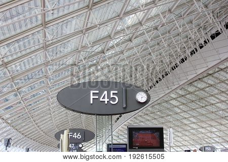 PARIS, FRANCE - JUNE 5, 2017: Paris Charles de Gaulle international Airport. Boarding gate sign at terminal 2F. Known as Roissy Airport, is a Europe second busiest airport. Main hub for Air France company and SkyTeam alliance partner Delta Air Lines.