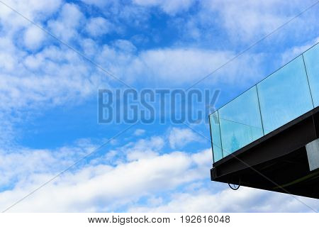Sky after rain as background with glass balcony
