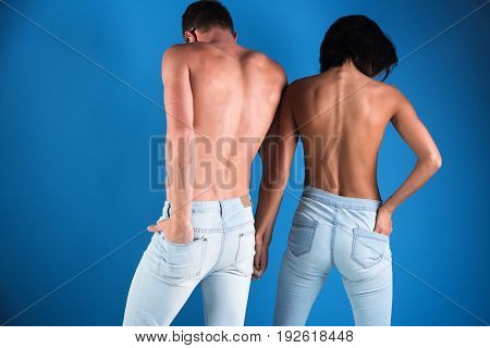 Gentle Married Couple In Jeans, Back View