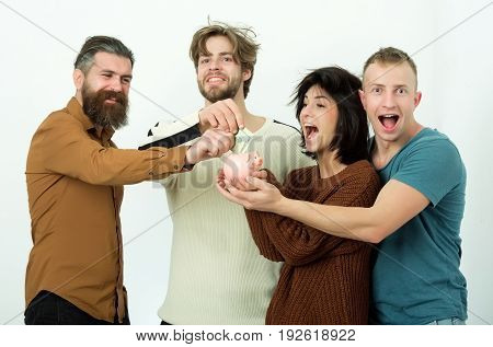 Group Of Friends Pointing At Dollars In Piggy Bank