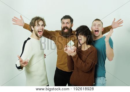 Excited Men And Cute Woman Putting Dollars In Piggy Bank