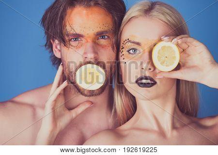 Man And Girl With Makeup Hold Lemon