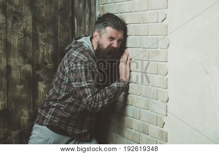 Man Screaming At Brick Wall
