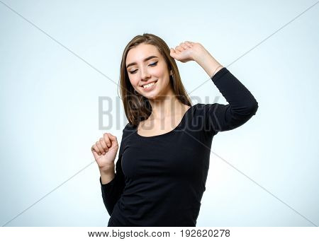 Portrait Of A Beautiful Young Woman Looking At The Camera And Smiling