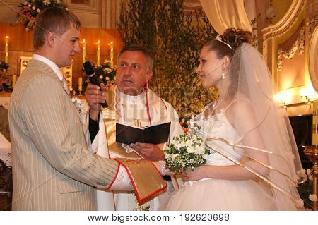 LUTSK UKRAINE - 24 May 2008: Wedding couple swear one to one at church