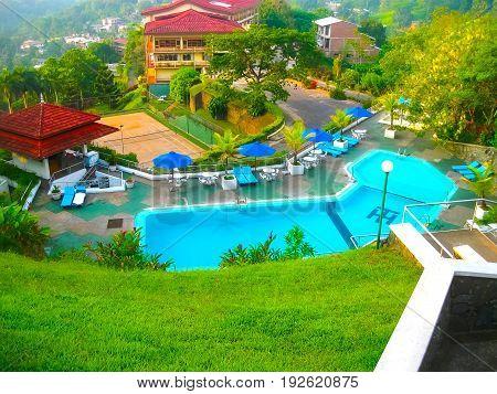 Kandy, Sri Lanka - May 02, 2009: Swimming pool of hotel Hotel Topaz 3 stars at Kandy, Sri Lanka on May 02, 2009