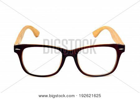vintage dark brown wooden glasses isolated on white background, clipping path