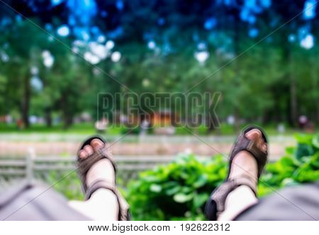 Tourist legs in sandals bokeh background hd