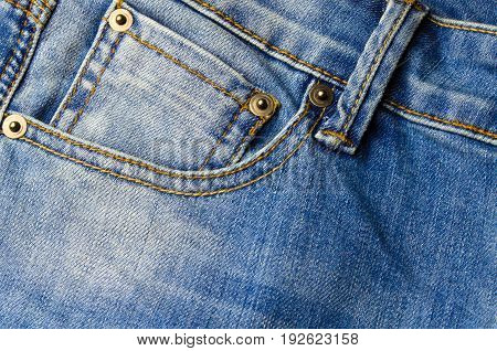close up view of front pocket vintage blue denim jeans pant fashion texture background selective focus