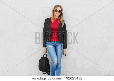 Fashionable Woman Dressed In Red Sweater, Jeans And Black Leather Jacket Wearing Trendy Sunglasses H