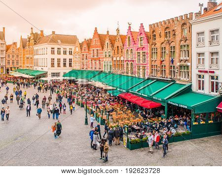 BRUGES, BELGIUM - OCTOBER 18, 2015: Market Square in Bruges with colorful houses and coffee gardens, Belgium on October 18, 2016.