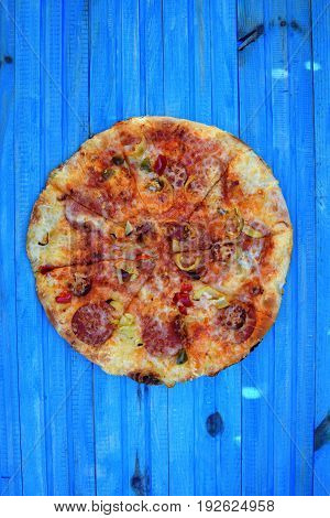 Hot homemade food. Sliced fresh italian classic salami pizza. Popular topping with cheese.