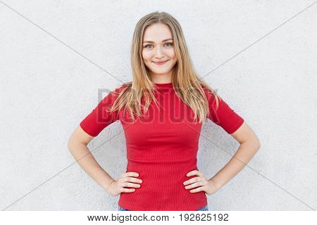 Portrait Of Young Woman With Wonderful Hair Having Delightful Expression Wearing Red Dress. Smiling