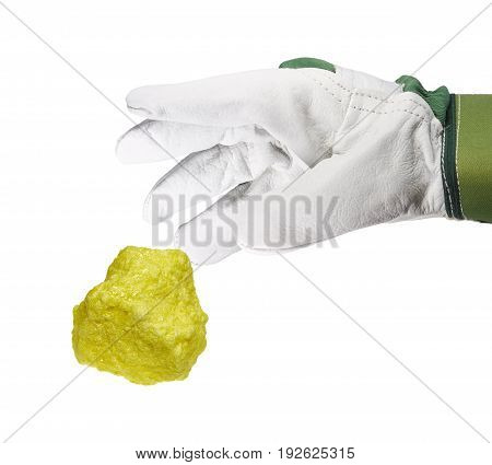 A hand with a glove grips a piece of sulfur.