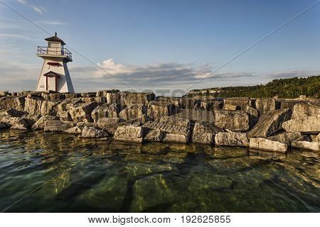 Lions Head Lighthouse on a late summer day. Located in Lion's Head Ontario Canada.