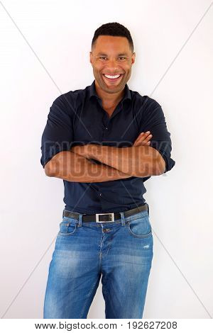 Confident Young Black Guy Standing With Arms Crossed And Smiling