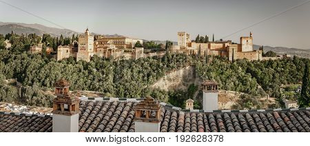 Panoramic view of ancient arabic fortress of Alhambra at sunset. Granada, Spain.